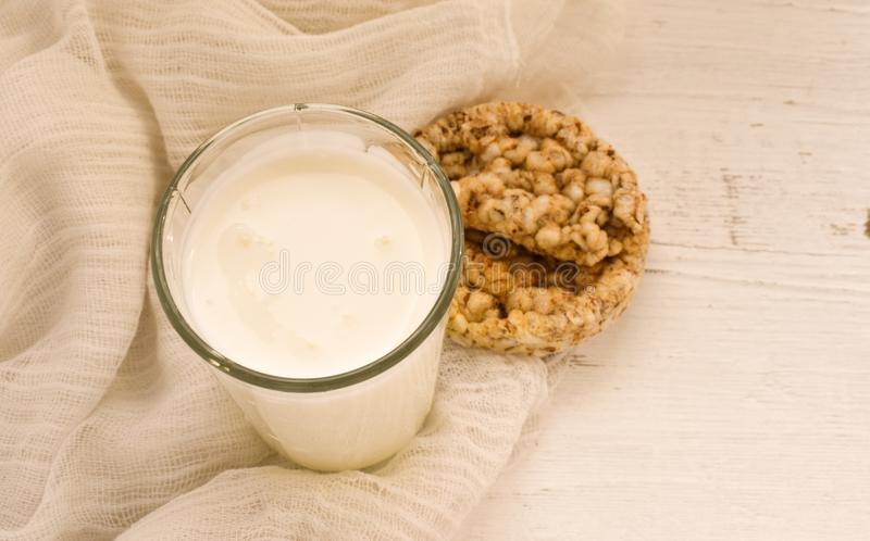 Kefir and oatmeal loaves healthy food for slenderness slim. Healthy diet food kefir drink drinking oatmeal loaves on white background slim isolated yellow white stock photos