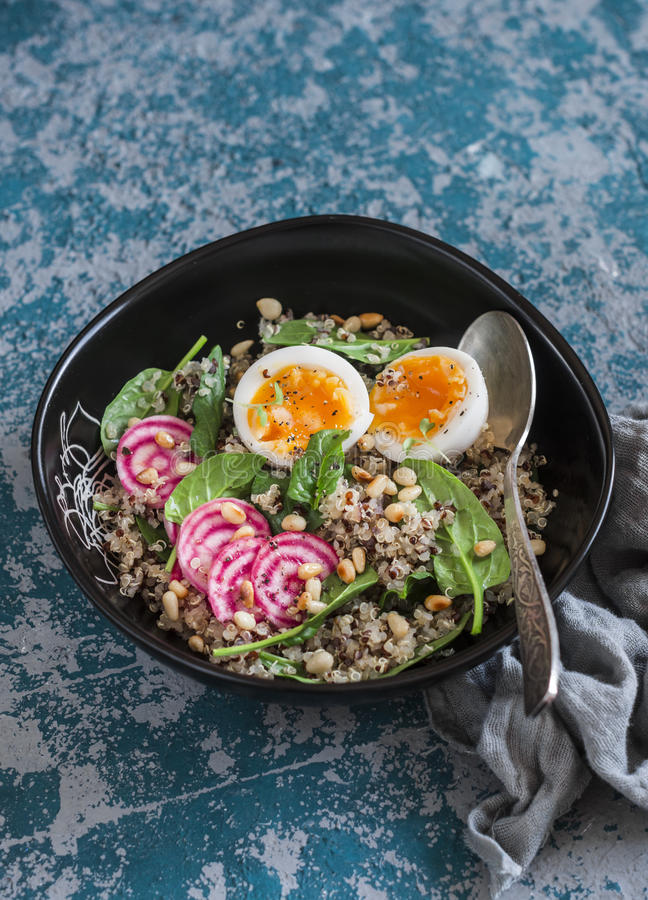 Healthy diet food - salad with quinoa, spinach, beets and boiled egg. stock photos