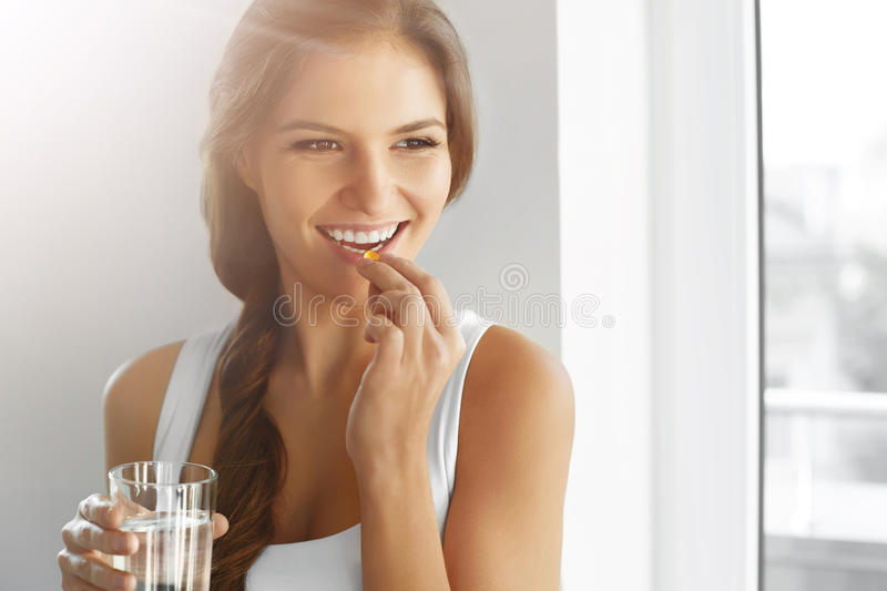Healthy Diet. Nutrition. Vitamins. Healthy Eating, Lifestyle. Woman With Fish Oil Capsules. stock images