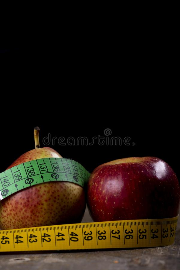 pear and apple representing types of overweight stock images