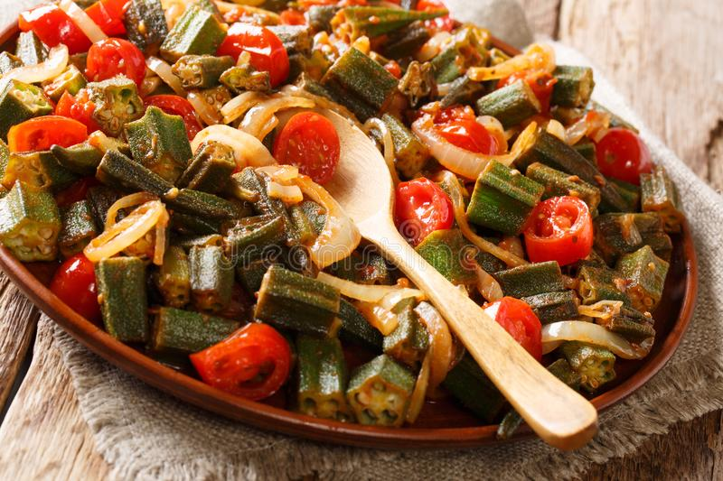 Healthy dietary meal okra with tomatoes and onion close-up on a stock photos
