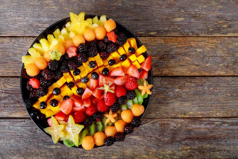 Healthy of different fruits on wooden table stock images