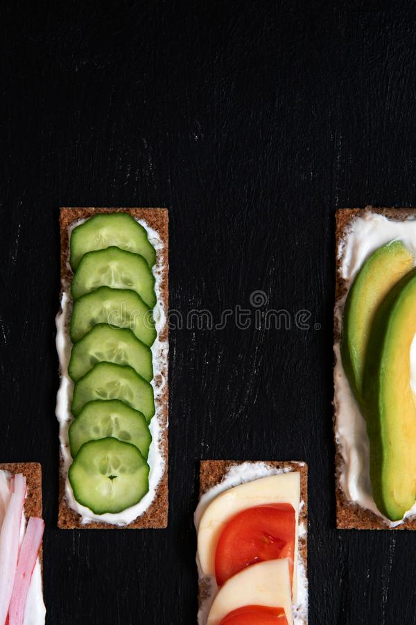 Healthy different rye sandwiches from whole grain rye crispbread. The concept of healthy eating stock photos