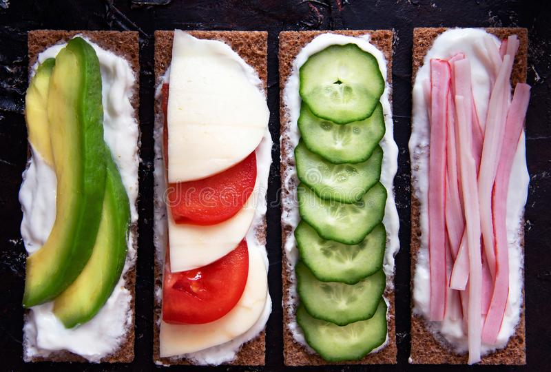 Healthy different rye sandwiches from whole grain rye crispbread. The concept of healthy eating. Background breakfast diet food fresh green meal snack tomato stock images