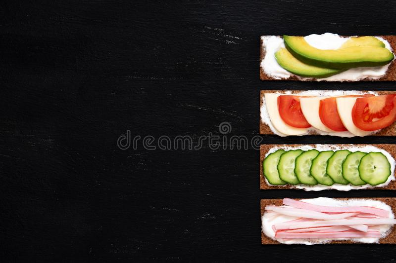 Healthy different rye sandwiches from whole grain rye crispbread. The concept of healthy eating. Background breakfast diet food fresh green meal snack tomato stock photo