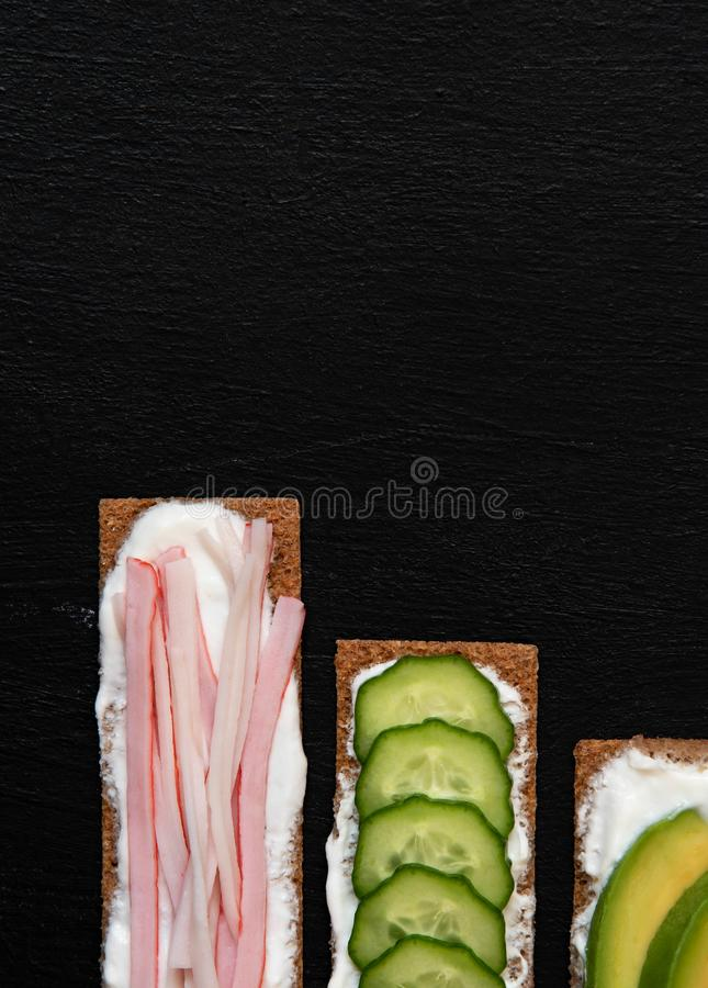 Healthy different rye sandwiches from whole grain rye crispbread. The concept of healthy eating. Background breakfast diet food fresh green meal snack royalty free stock photography