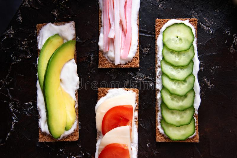 Healthy different rye sandwiches from whole grain rye crispbread. The concept of healthy eating. Background breakfast diet food fresh green meal snack tomato stock image