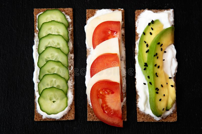 Healthy different rye sandwiches from whole grain rye crispbread. The concept of healthy eating. Background breakfast diet food fresh green meal snack tomato royalty free stock photos