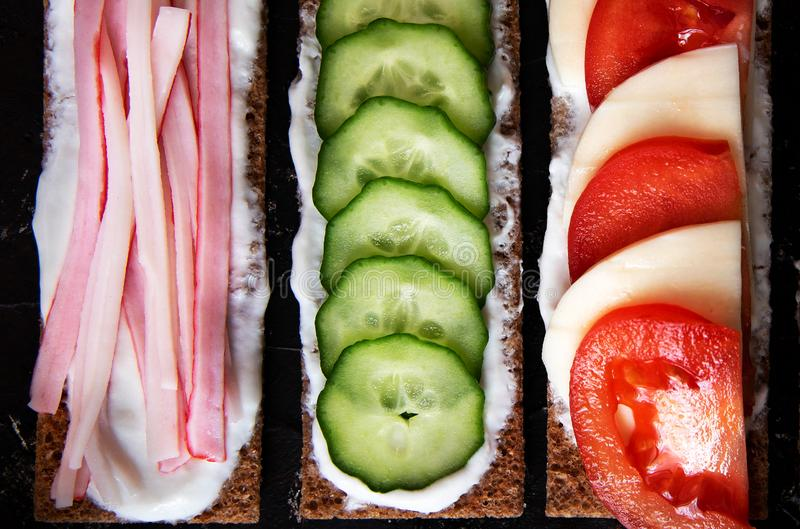 Healthy different rye sandwiches from whole grain rye crispbread. The concept of healthy eating. Background breakfast diet food fresh green meal snack tomato stock photos