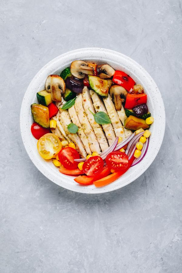 Healthy dinner buddha bowl lunch with chicken, quinoa, grilled and fresh vegetables stock image