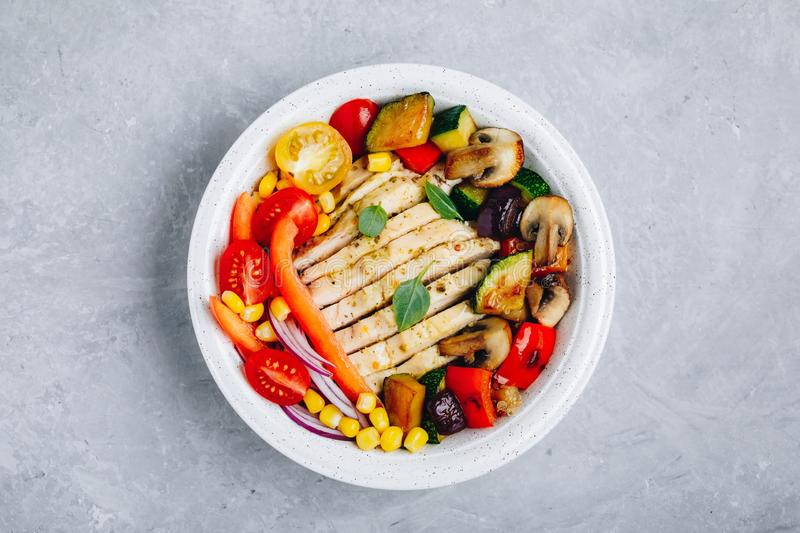 Healthy dinner buddha bowl lunch with chicken, quinoa, grilled and fresh vegetables royalty free stock photo