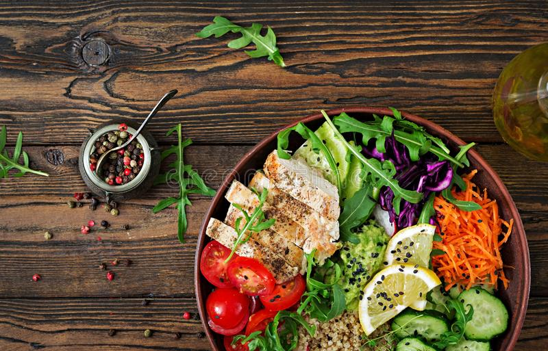 Buddha bowl lunch with grilled chicken and quinoa, tomato, guacamole. Healthy dinner. Buddha bowl lunch with grilled chicken and quinoa, tomato, guacamole royalty free stock photo