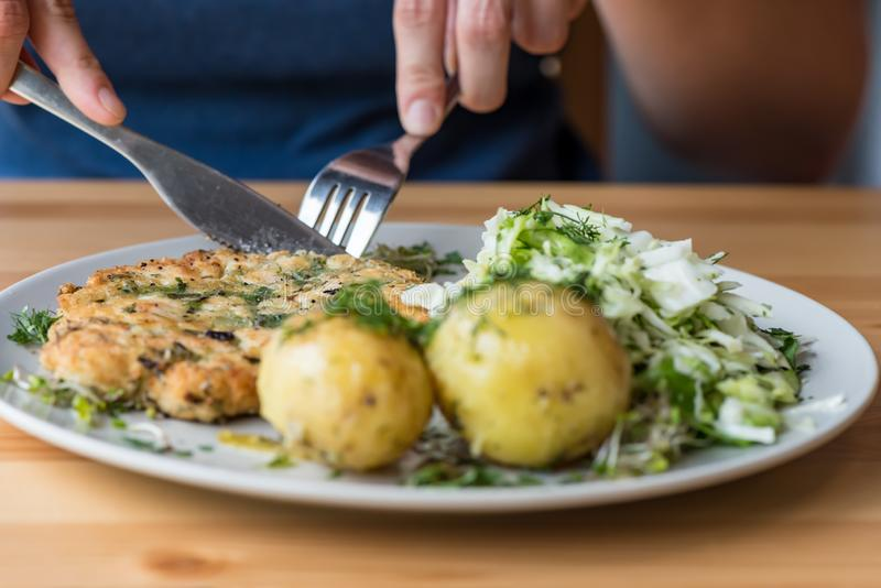A healthy dinner made at home - Chicken meatballs with fresh potatoes stock photography