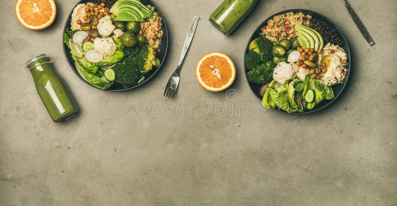 Healthy dinner with superbowls and smoothies in bottles, copy space stock photos