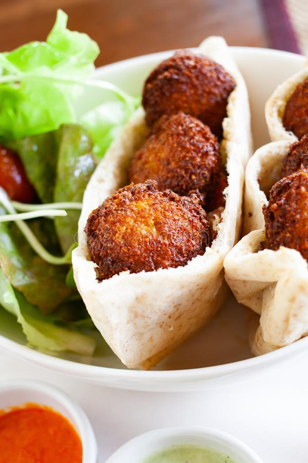healthy dish of falafel with salad stock photography