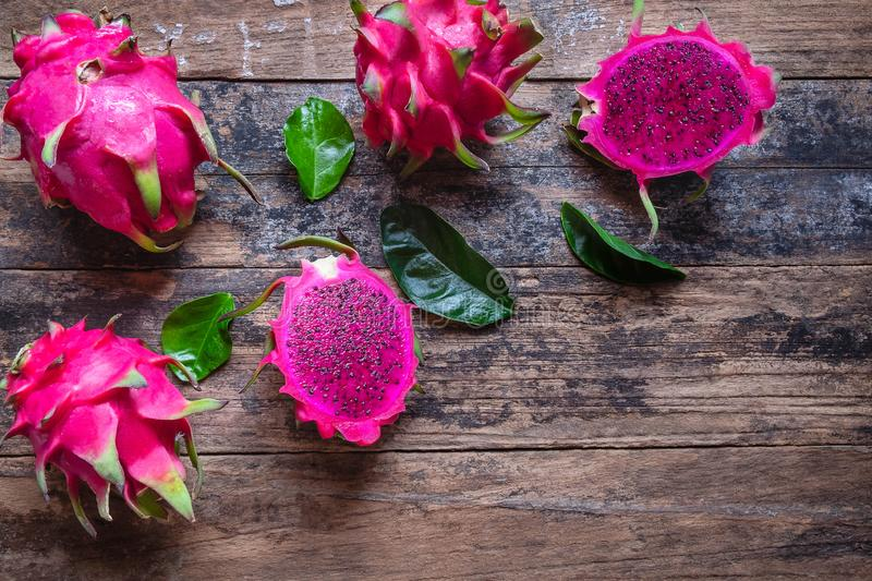 Healthy dragon fruits on wooden background royalty free stock images