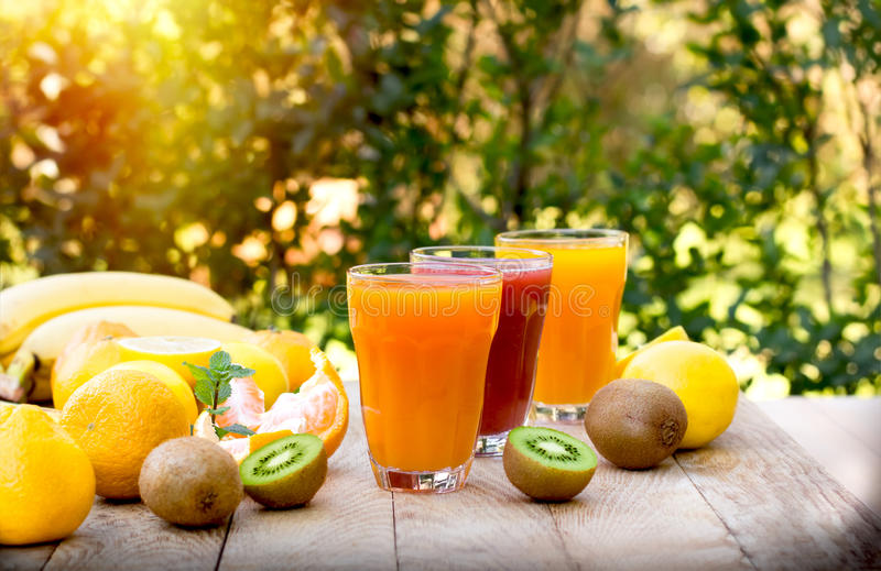 Healthy drink - beverages (fruit juices). Healthy drinks - beverages (fruit juices) and fruits on table stock images