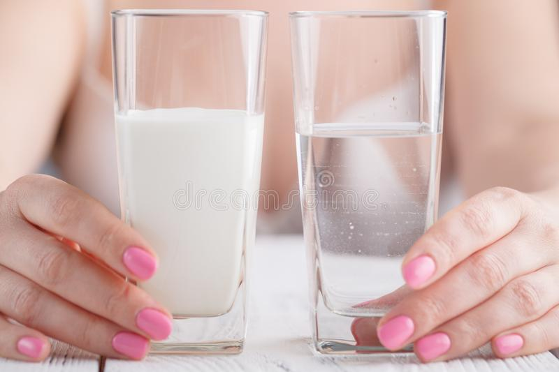 Healthy drinks in female hands stock photography