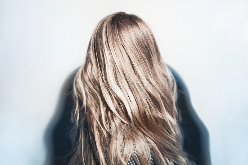 Healthy dyed blond hair of young woman. Beautiful healthy dyed blond hair of young woman stock photos