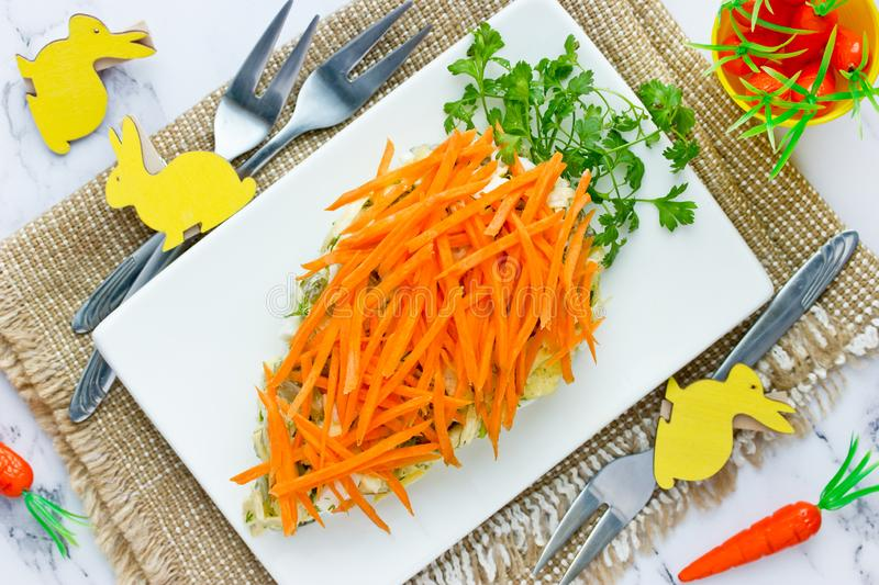 Healthy Easter treat idea - carrot shaped salad. Healthy Easter treat idea - carrot shaped appetizer salad decorated with fresh carrot and green parsley for royalty free stock image