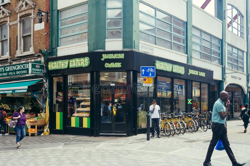 Healthy Eaters, jamaican cuisine restaurangen i Brixton, London royaltyfri foto