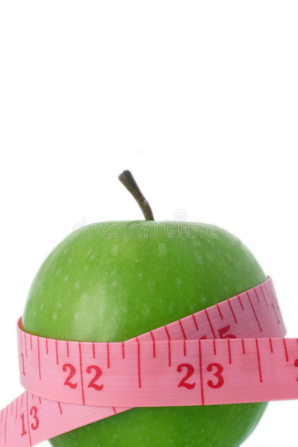 Healthy eating. Tape measure and apple, eating healthy stock photo