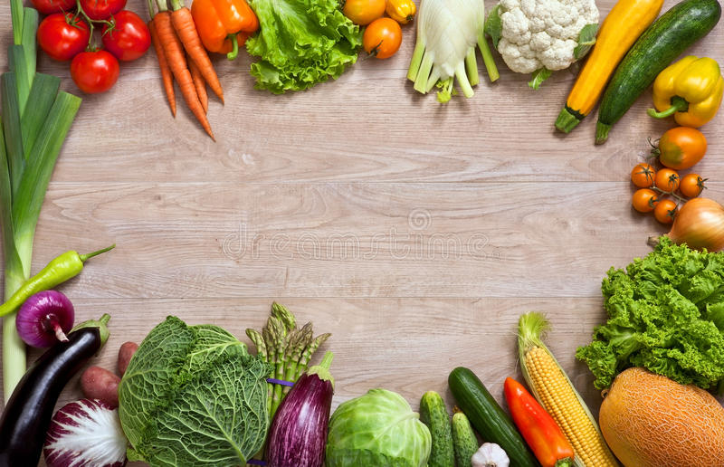 Healthy eating background. Studio photography of different fruits and vegetables on wooden table stock photos