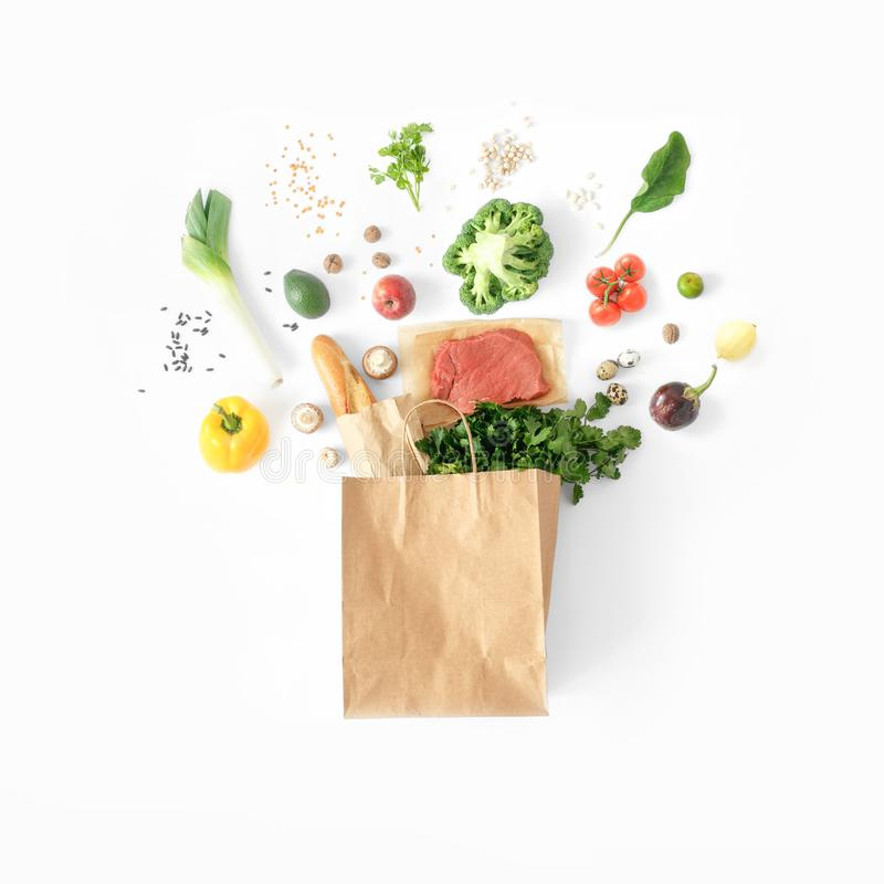 Healthy eating background top view Full paper bag healthy food. Healthy eating background, top view. Full paper bag of different health food on white background stock images