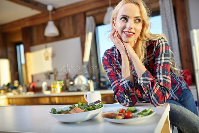 Healthy Eating, Breakfast, Women. Woman in home eating breakfast royalty free stock photography
