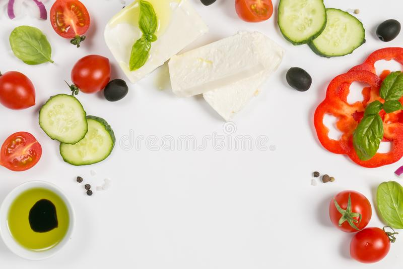 Healthy eating concept - selection of greek salad ingredients on white background stock photography