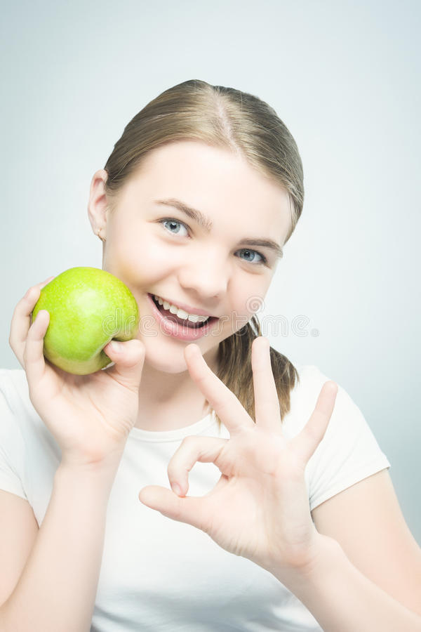 Healthy Eating Concept:Teenage Girl Holding Apple royalty free stock photography