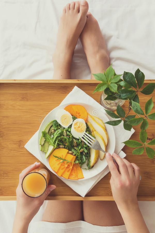 Download Healthy Eating Concept. Woman Having Breakfast In Bed Stock Photo - Image of eating, legs: 107020472