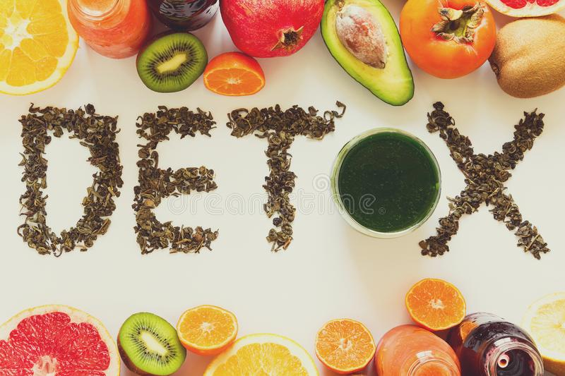 Healthy eating concept. Word `detox` from green tea with colorful smoothies and fruits. Healthy eating concept. Word `detox` from green tea with colorful stock photos