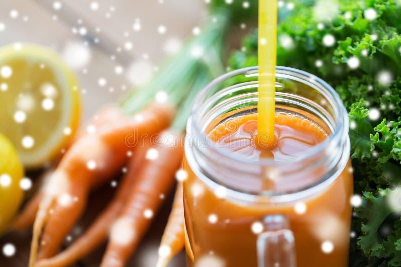 Close up of glass jug or mug with carrot juice stock photography