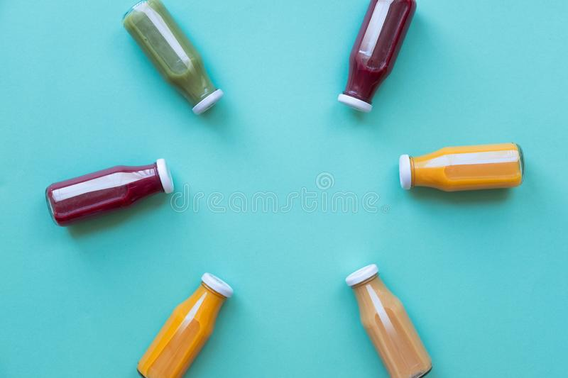 Healthy eating, drinks, diet and detox concept - close up of bottles with different fruit or vegetable juices. Healthy eating, drinks, diet and detox concept royalty free stock image