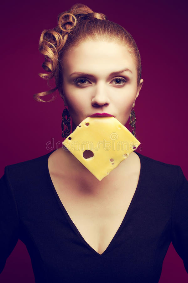 Healthy eating. Food concept. Arty portrait of girl eating cheese stock photo