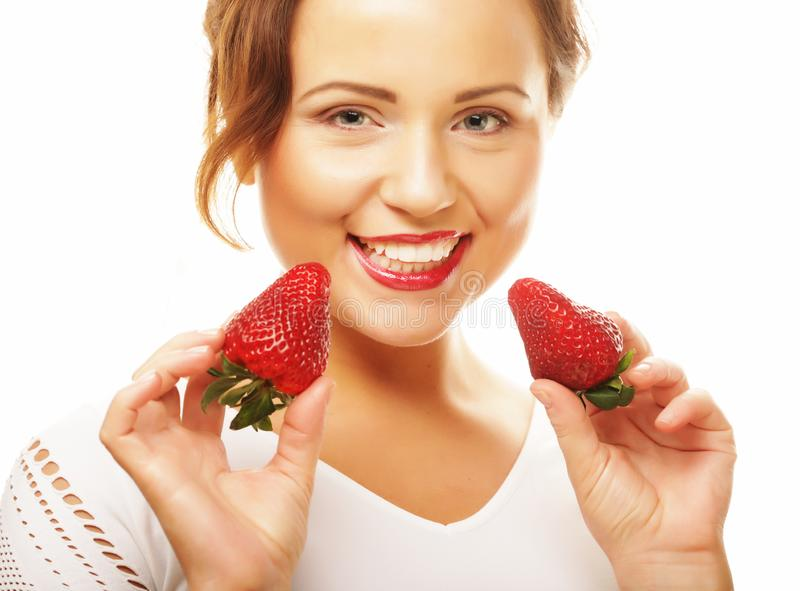 Healthy eating, food and diet concept - Young beautiful happy smiling woman with strawberry stock photos