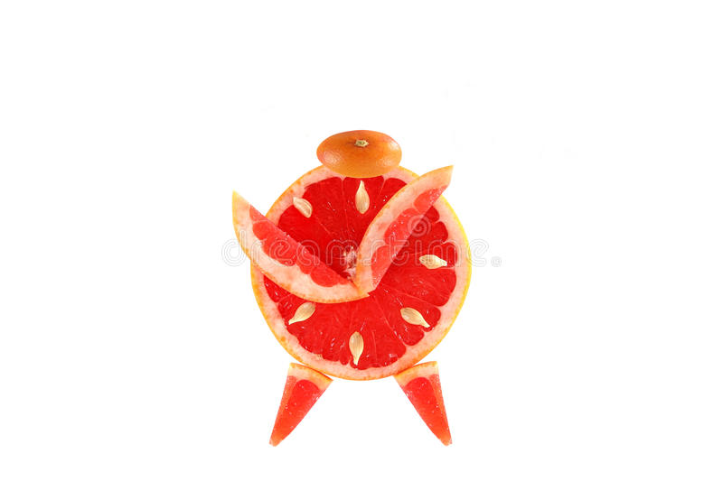 Healthy eating. Funny alarm clock made of the grapefruit slices. stock photo