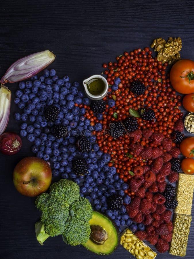 Healthy heart food, heart shaped. Healthy eating and heart health concept with a heart shaped with blueberries, raspberries, strawberries, avocado, nuts stock photos