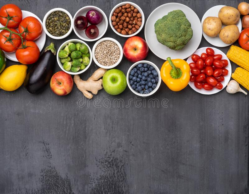 Healthy eating ingredients: fresh vegetables, fruits and superfood. Nutrition, diet, vegan food concept stock photography