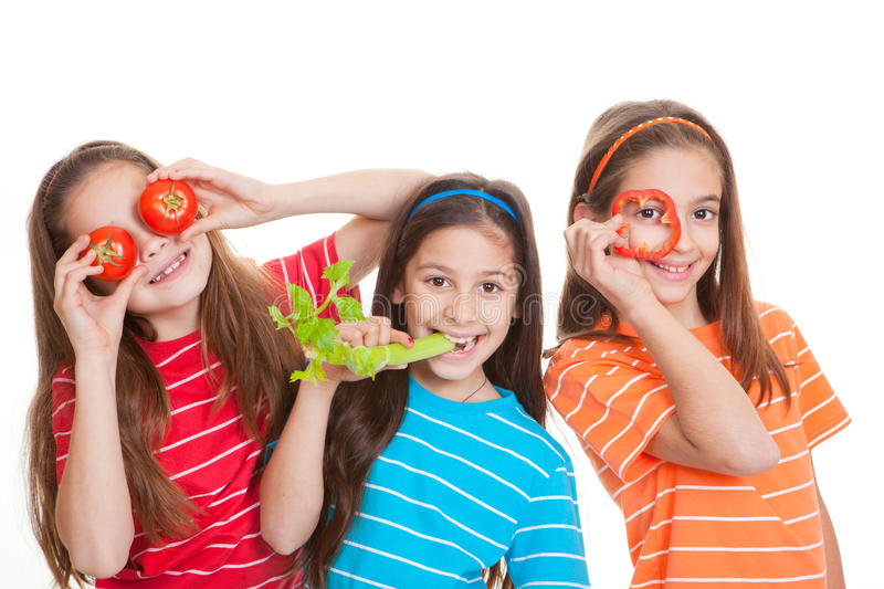 Healthy eating kids concept. Healhty eating kids concept, children with vegetables stock image