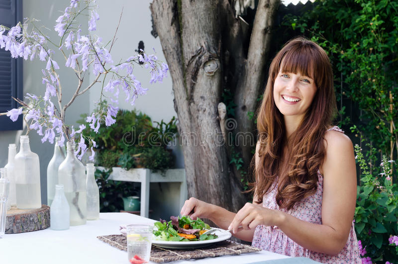 Healthy eating lifestyle woman having salad outdoors royalty free stock photography