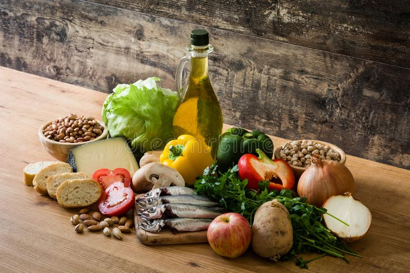 Healthy eating. Mediterranean diet. Fruit,vegetables, grain, nuts olive oil and fish royalty free stock images