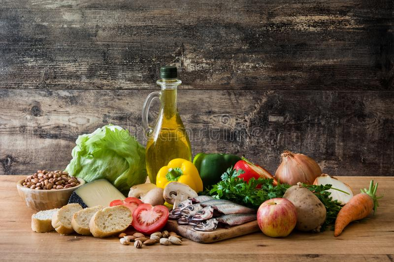 Healthy eating. Mediterranean diet. Fruit,vegetables, grain, nuts olive oil and fish. On wooden table royalty free stock photography