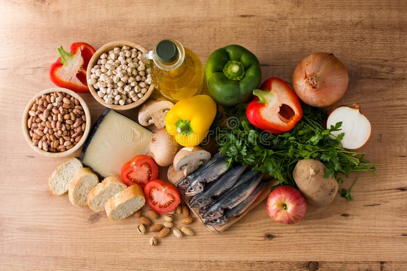 Healthy eating. Mediterranean diet. Fruit,vegetables, grain, nuts olive oil and fish royalty free stock photo