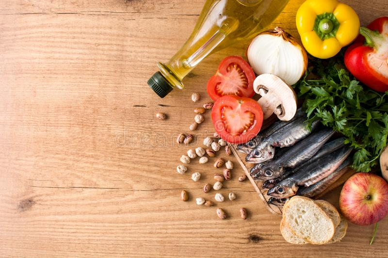 Healthy eating. Mediterranean diet. Fruit,vegetables, grain, nuts olive oil and fish. On wooden table. Top view. Copyspace stock photography