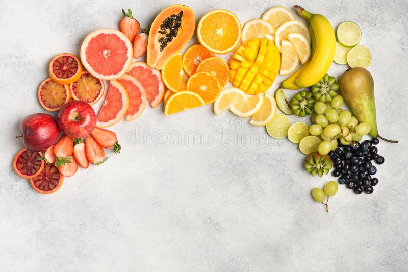 Top view of rainbow fruits and berries. Healthy eating, top view of healthy fruits in rainbow colours, strawberries, mango, grapes, bananas, grapefruit on the stock images