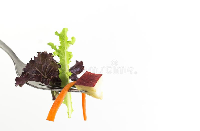 Healthy eating. Vegetables on fork for healthy eating concept   with isolated on white background stock images