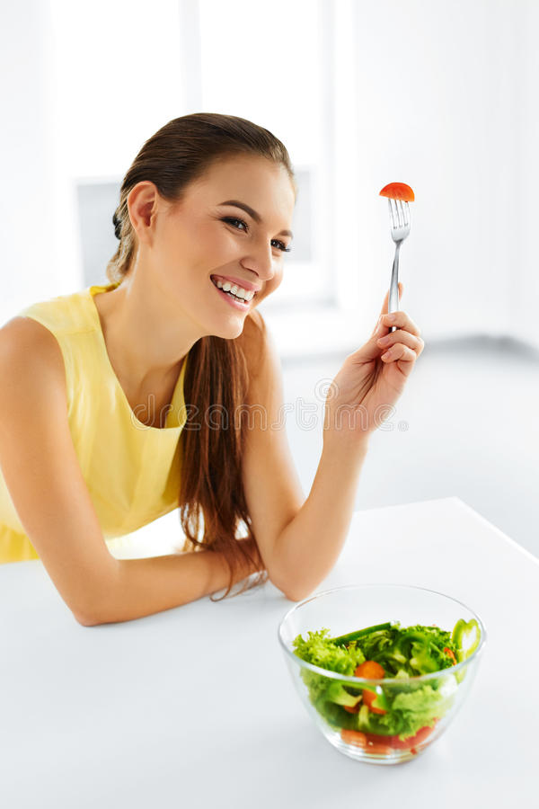 Healthy Eating. Vegetarian Woman Eating Salad. Food, Lifestyle, stock photo