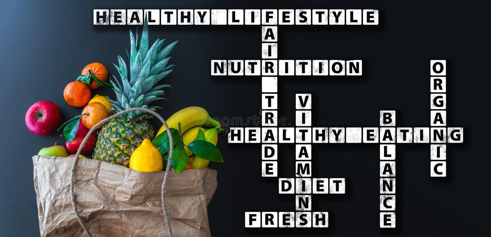 Healthy eating wordcloud or crossword with variety of fresh fruits in brown paper bag royalty free stock images